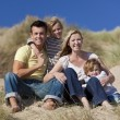 Mother, Father and Two Boys Sitting Having Fun At Beach — Stock Photo #6470167