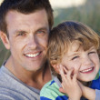 Stock Photo: Man & Boy, Father and Son Having Fun At Beach