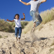 Stock Photo: Man & Girl, Happy Father and Daughter Jumping At Beach