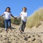 Blond Boy & Mixed Race Girl Running At Beach — Stock Photo #6470180