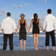 Four Young , Two Couples, Holding Hands On A Beach — Stock Photo #6478828