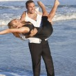 Man and Woman Couple Having Romantic Fun On Beach — Stock Photo