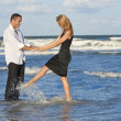 Stock Photo: Man and Woman Couple Having Fun Dancing On A Beach