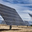 HDR Photograph of Green Energy Photovoltaic Solar Panels - Stock Photo