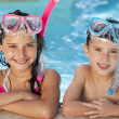Boy and Girl In Swimming Pool with Goggles and Snorkel - Stock Photo