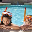 Stock Photo: Boy and Girl In Swimming Pool with Goggles & Snorkel
