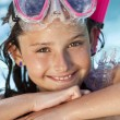 Happy Girl Child In Swimming Pool with Goggles and Snorkel — Stock Photo