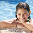 Happy Girl Leaning On The Edge Of A Swimming Pool — Stock Photo