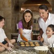 Attractive Family Baking and Eating Cookies In A Kitchen — Stockfoto