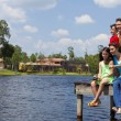 Mother, Father, Son & Daughter Family Fishing On Jetty — Stock Photo