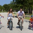 Royalty-Free Stock Photo: Modern Family Parents and Children Cycling