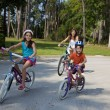 Modern Family Parents and Children Cycling — Stock Photo