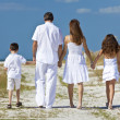 Mother, Father and Children Family Walking At Beach — Stock Photo