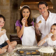 Attractive Family Baking and Eating Cookies In A Kitchen — Stock Photo #6479306