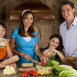 Attractive Family In Kitchen Making Healthy Sandwiches - Stock Photo