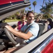 Family Driving Red Convertible Car — Stockfoto