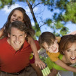 Happy Family Having Fun Outside In Park - 