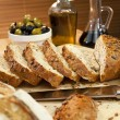 Sliced Rustic Bread, Olive Oil, Stuffed Green & Black Olives — Stock Photo