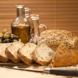 Fresh Cut Rustic Bread, Olive Oil &amp; Green and Black Olives - Stock Photo