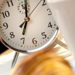Alarm Clock and Continental Breakfast of Croissant & Coffee - Stock Photo