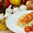 Seared Chili Salmon Fillet With Pesto Spaghetti &amp; Rocket Salad - Stock Photo