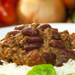 Chili Con Carne On Rice With Basil Garnish - Stock Photo