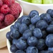 Bowls of Healthy Breakfast Blueberries Raspberries and Grapes — Stock Photo