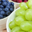 Royalty-Free Stock Photo: Bowls of Healthy Grapes, Blueberries and Raspberries