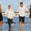 Four Young , Two Couples, Having Fun Running On Beach — Stock Photo