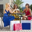 Royalty-Free Stock Photo: Three Beautiful Young Women Having Coffee With Shopping Bags