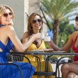 Three Beautiful Young Women Having Coffee At City Cafe — Foto de Stock