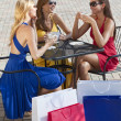 Three Beautiful Young Women Having Coffee With Shopping Bags — Stock Photo