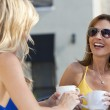 Two Beautiful Young Women Laughing and Drinking Coffee — Stock Photo