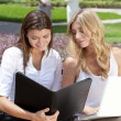 Two Young Businesswoman Outside Meeting With Laptop & Folder — Stock Photo