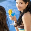 beautiful hispanic latina woman drinking a cocktail with her fri — Stock Photo