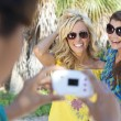 Three Young Women Friends Taking Pictures On Vacation — Stock Photo #6479817