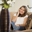 Attractive Young Woman On Her Cell Phone At Home — Stock Photo #6479858