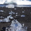 Icebergs Breaking On Black Sand Beach In Iceland — Stock Photo