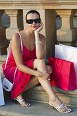 Beautiful Latina Hispanic Woman Sitting With Shopping Bags — Stock Photo