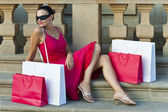Beautiful Latin Woman In Red Dress With Shopping Bags — Stock Photo