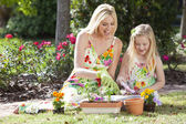 Woman and Girl, Mother & Daughter, Gardening Planting Flowers — Foto de Stock
