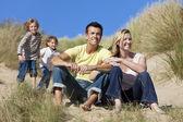 Family Sitting on Beach Having Fun — Stock Photo