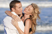 Man and Woman Couple In Romantic Embrace On A Beach — Stock Photo
