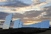 A Field of Green Energy Solar Mirror Panels at Sunset — Stock Photo