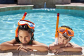 Boy and Girl In Swimming Pool with Goggles & Snorkel — Stock Photo