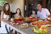 Attractive Family Eating Healthy Salad and Food Meal — Stock Photo