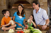 Attractive Family In Kitchen Making Healthy Sandwiches — Photo