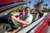 Family Driving Red Convertible Car — Stock Photo