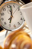 Alarm Clock and Continental Breakfast of Croissant & Coffee — Stock Photo