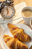 Continental Breakfast Croissant, Coffee & Alarm Clock — Stock Photo